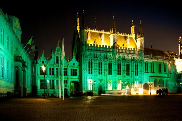 REPRO FREE 17/03/2016, Bruges, Belgium – Tourism Ireland's annual Global Greening initiative, to celebrate the island of Ireland and St Patrick, has gone from strength to strength – from its beginning in 2010, with just the Sydney Opera House going green, to this year, when about 180 landmark buildings and iconic sites across the world will turn a shade of green for our national day. PIC SHOWS: The Burg (town hall) in Bruges joins Tourism Ireland's Global Greening, to celebrate the island of Ireland and St Patrick. Pic – Geoffrey Fritsch (no repro fee) Further press info – Sinéad Grace, Tourism Ireland 087 685 9027